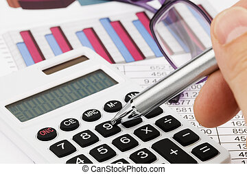 Graphics calculator and a balance sheet - A calculator with...