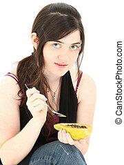 Attractive Young Woman Eating Papaya Fruit