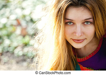Outdoor portrait of young cute woman