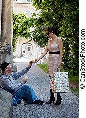 Beggar woman is eating