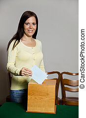 Women in the election with ballots and ballot box - A young...
