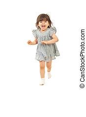 Laughing toddler girl running