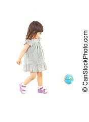 Toddler girl playing with world globe - Toddler girl in...
