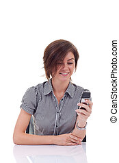 business woman sending a text message on her mobile phone