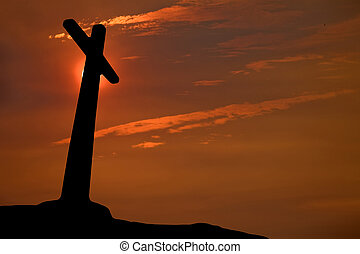 sunset cross - cross silhouette with the sunset as...