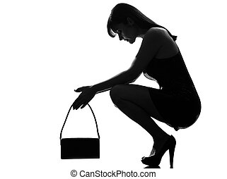 stylish silhouette woman crouching thinkig despair - stylish...