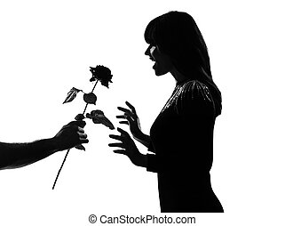 silhouette man hand offering a flower rose