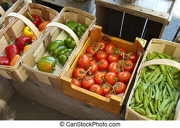Vegetables at farm stand - Assorted vegetables in baskets at...