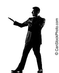 silhouette  man  showing gesture introducing presentation