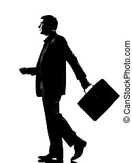 silhouette man walking profile with briefcase - silhouette...