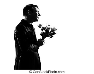 silhouette  man offering flowers