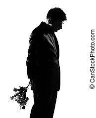 silhouette man offering flowers - silhouette caucasian...