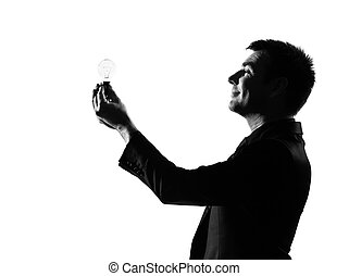 silhouette  man  holding light bulb