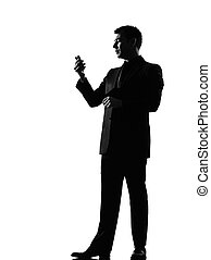 silhouette man on the phone sms text messaging - silhouette...