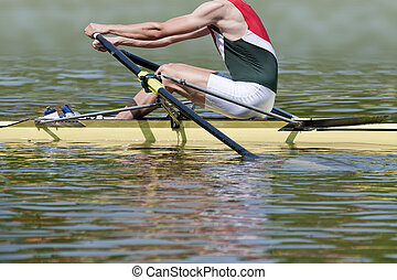Skiff rower explodes into action at the starting signal of a...