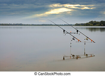 fishing rods on river at morning