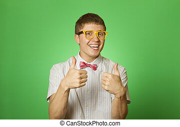 Happy young man two thumbs up - Handsome young man in a...