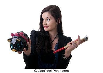 woman coinbank hammer - a young woman holding a piggy bank...