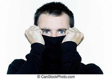 man hiding behind his turtle polo neck afraid - caucasian...