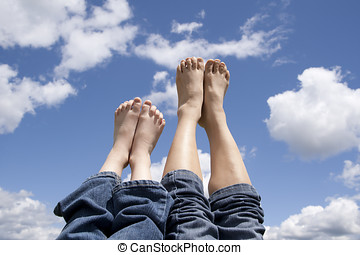 Mother and daughter feet. - Feeling relaxed and letting the...