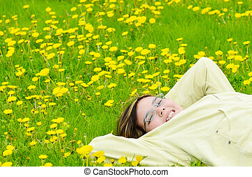 Girl Relaxing In The Sun - A young preteen girl is lying in...