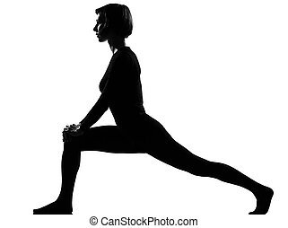 woman exercising fitness yoga stretching in shadow grayscale...