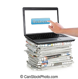 business icon of laptop and newspaper - newspaper and laptop...