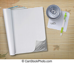 conceptual of open blank book with soda can and pen