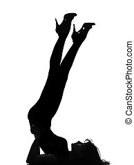 silhouette woman liying on floor gymnastic legs - full...