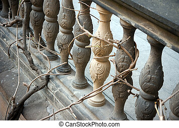 Bannister - Close up of a banister with a plant