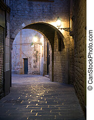 Narrow street in Barcelona - Narrow street with archway in...
