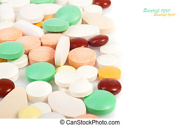 tablets - medicines, tablets of different colors on a white...