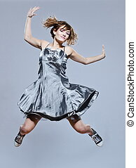 beautiful young girl with prom dress jumping happy -...