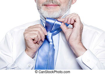 Senior man portrait tie knot lesson - caucasian senior man...