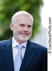 Senior businessman portrait smiling friendly