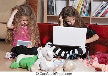 Little girls game console misunderstand - caucasian little...
