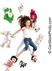 Little girl surrounded by toys laughing