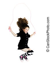 Little girl jumping skipping rope - caucasian little girl...