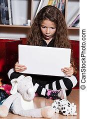 Little girl computing stuned