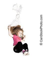 Little girl sliding with blanket