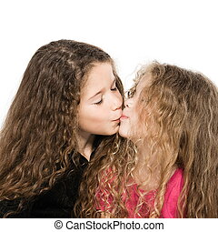 Two little girls portrait kissing - two caucasian little...