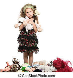 Little girl with toys - caucasian little girl with toys...