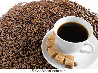 Coffee cup on pile of beans