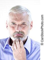 Senior man portrait pensive suspicion - caucasian senior man...