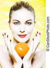 Woman portrait holding a orange - beautiful caucasian woman...