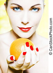 Woman Portrait offer an orange smiling - beautiful caucasian...