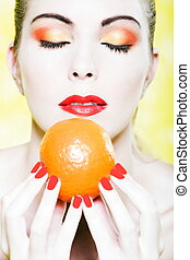 Woman portrait smell orange fruit - beautiful caucasian...