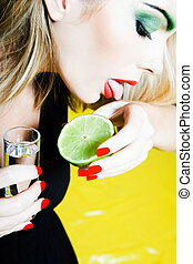 Woman Portrait licking salt with tequila shot