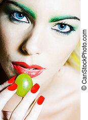 Woman Portrait eating grape