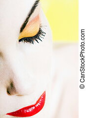 Beautiful Woman eyes closed with colorful make up  portrait